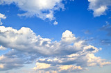 Background of blue sky with white cumulus clouds poster