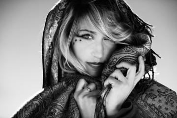 Stunning blonde model portrait with face veil - monochrome