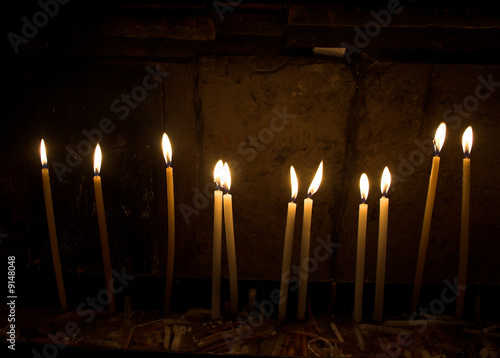 Close-up shot of candles in a Christian church