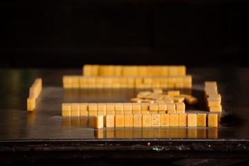 Mahjong tiles set up for a game
