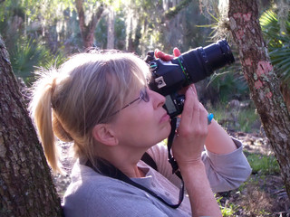 Senior lady photographing Florida nature & wildlife