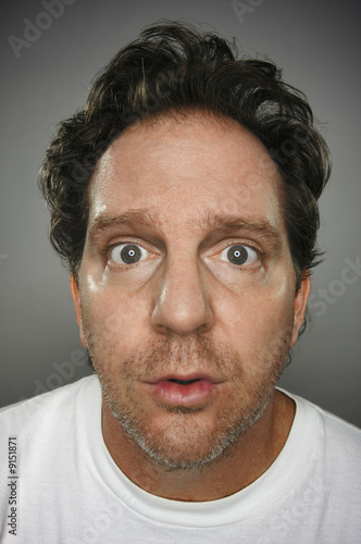 Dumbfounded Looking Man on a Grey Background