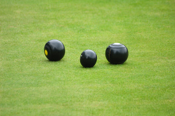Three bowls on bowling green