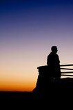 Image of a man looking at a amazing view at sunset
