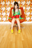Happy girl with heart box shapped on knees poster