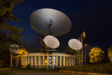 A large satellite dish for telecommunications industry poster