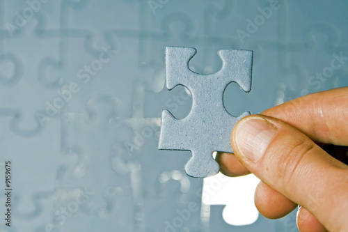 poster of Inserting last piece of puzzle