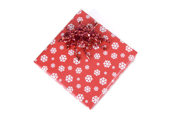 Gift box wrapped in the paper with the bow