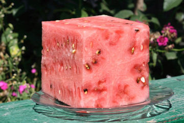 watermelon in form cuba on nature background