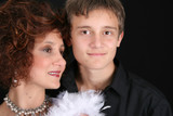 Rich and stylish mother and son in formal attire poster