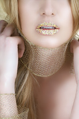 woman with gold leaf on her lips and long blond hair