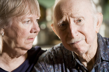 Close Up Portrait of Worried Senior Couple