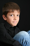 Young boy with big eyes in casual attire poster