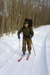 full-length portrait of a skiing hunter nab
