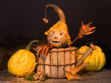 Autumn figurine with pepper hands and gourd face