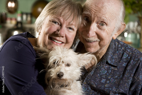 Close Up Portrait of Senior Couple with Dog