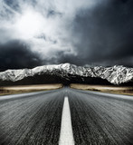 Fototapety Motion blurred road heading to the Mountains