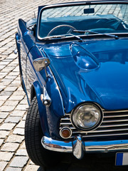 Blue Oldtimer in perfect condition posing on a street