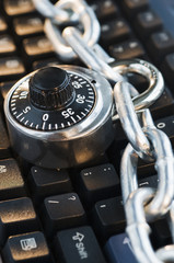 Combination Lock with Chain on Keyboard.