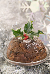 Traditional Christmas pudding in a silver snowflake setting