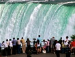 People on falling water background. Niagara Falls