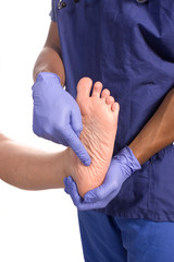 Doctor podiatrist checking patients foot