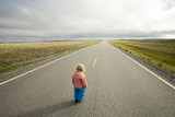 little girl standing at the beginning of road going to horizon poster