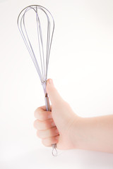 Holding whisk upright