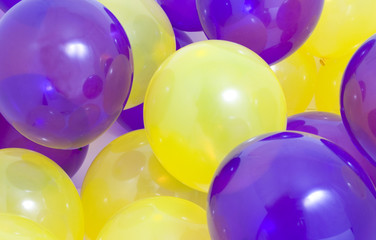 Many yellow and purple balloons background