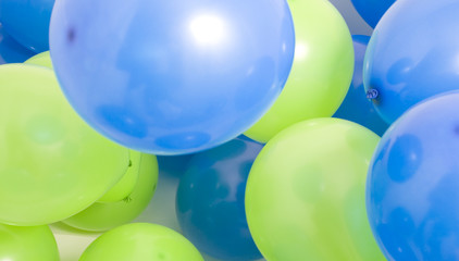 Green and blue multicolored balloons background