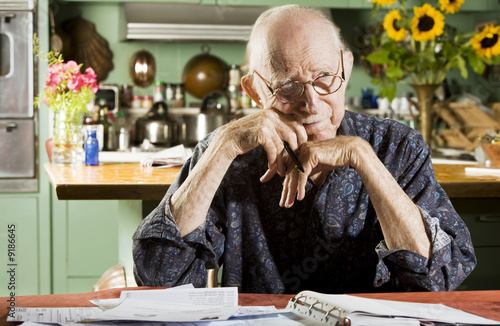 Elder Man at Home with Bills