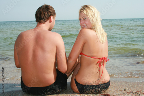 attractive couple fooling around on the beach