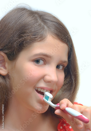 Girl with toothbrush isolated on white for your design