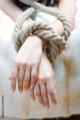 Bound hands of young beautiful woman