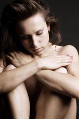 portrait of sad woman over dark background