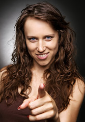 young woman pointing her finger at you