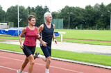 Two running pensioners having a healthy lifestyle. poster