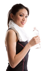 A shot of a beautiful asian girl holding a bottle of water