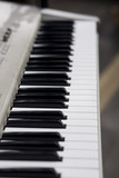 A selective focus image down an electronic keyboard. poster