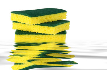 Yellow sponges with green scrubbers isolated on white background
