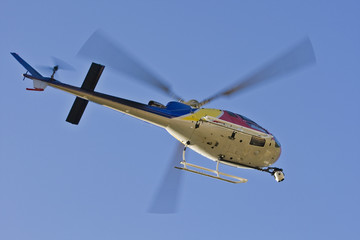 A helicopter with a camera. A motion blur on rotor blades