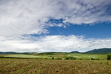 Hungarian rustic landscape with hills and many clouds poster