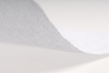 Macro studio shot of a white toilet paper.