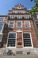 Historic Dutch house with bicycle parked in front