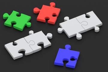 Colorful puzzle pieces isolated ower a dark background.