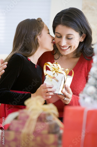 Girl Surprising Her Mother With Christmas Gift