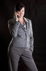 brunette on the phone black isolated background