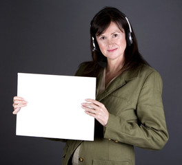 brunette with headset and board on the grey background