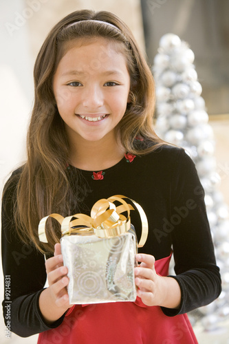 Young Girl Smiling,Holding Christmas Gift