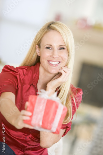 Woman Handing Out Christmas Present